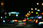 Blurred view of city at night. Bokeh effect