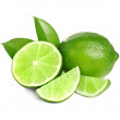 Fresh ripe green limes isolated on white...