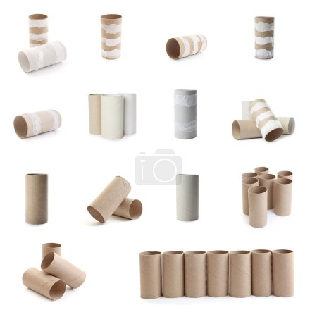 Set with empty paper toilet rolls on white backgro...