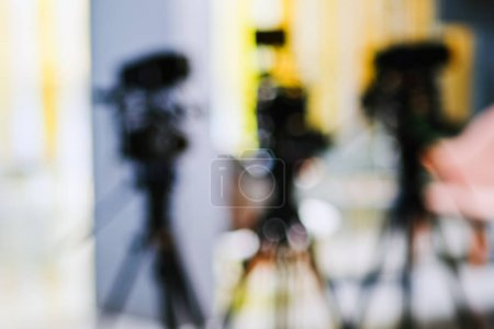 Photo for Abstract blurred background of video camera shooting  in studio, recording movie production - Royalty Free Image