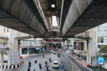 BANGKOK , THAILAND - DECEMBER 12, 2017: Cars and motorcycles on road in Bangkok, Thailand
