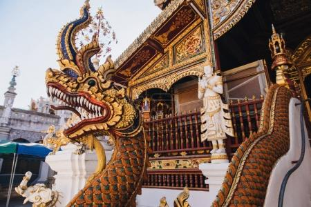 Photo for Close-up view of statue of dragon near ancient temple in Chiang Mai, Thailand - Royalty Free Image