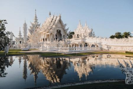 Photo for Wat Rong Khun White Temple reflected in water, Chiang Rai, Thailand - Royalty Free Image