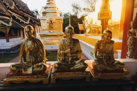 Photo for Golden religious statues in ancient temple at Chiang Mai, Thailand - Royalty Free Image