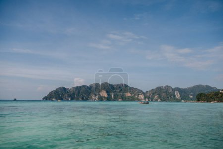 Photo for Beautiful cliffs and boats on calm water at Phi-Phi island, Thailand - Royalty Free Image