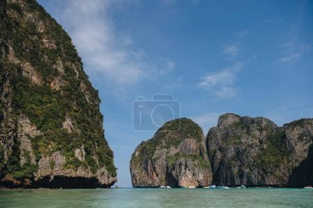 Photo for Beautiful cliffs with green vegetation and calm water at Phi-Phi island, Thailand - Royalty Free Image