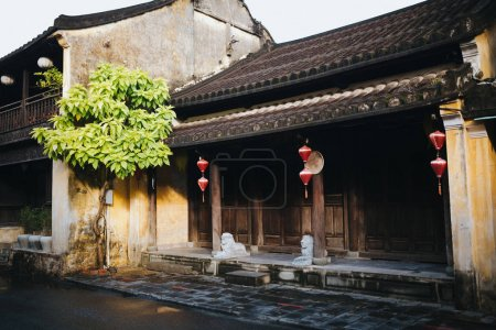 Photo for Beautiful traditional oriental architecture with red lanterns and statues in Hoi An, Vietnam - Royalty Free Image