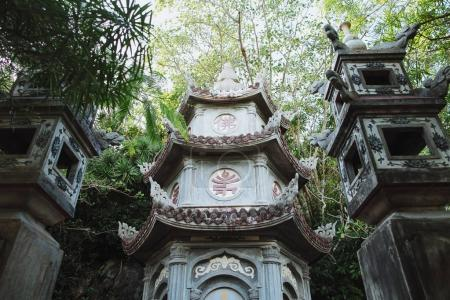 Photo for Low angle view of ancient traditional oriental temple between green plants, Da Nang, Vietnam - Royalty Free Image