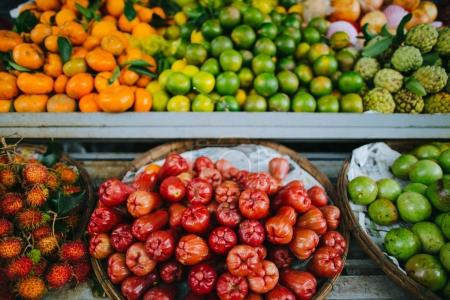 Photo for Close-up view of exotic fruits in baskets on shelves, Hoi An, Vietnam - Royalty Free Image