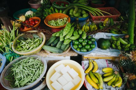 Photo for Healthy organic fruits and vegetables on stall in Hoi An, Vietnam - Royalty Free Image