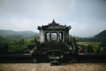 Photo for Traditional ancient oriental architecture in green park, Hue, Vietnam - Royalty Free Image