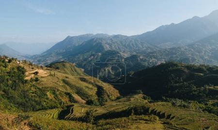 Photo for Landscape with scenic mountains and green vegetation on hills at Sa Pa, Vietnam - Royalty Free Image