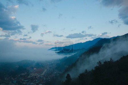 Photo for Town in beautiful mountains and clouds at evening in Sa Pa, Vietnam - Royalty Free Image