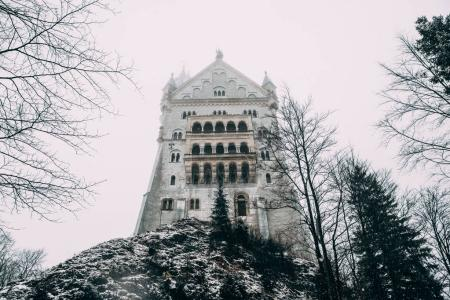 Photo for FUSSEN, GERMANY - FEBRUARY 19, 2018: majestic medieval neuschwanstein castle in fog - Royalty Free Image