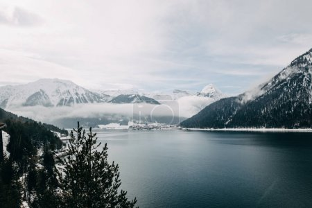 Photo for Beautiful landscape with snow-capped mountains and majestic tranquil mountain lake in austria - Royalty Free Image
