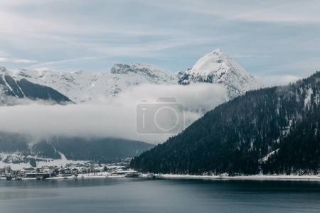 Photo for Beautiful scenic landscape with snow-covered mountains and majestic mountain lake in austria - Royalty Free Image