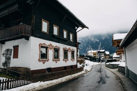 Photo for MAYRHOFEN, AUSTRIA - FEBRUARY 19, 2018: cozy narrow street with traditional houses in mayrhofen, austria - Royalty Free Image