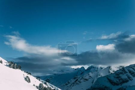 Photo for Amazing snow-capped mountain peaks and cloudy sky, mayrhofen, austria - Royalty Free Image