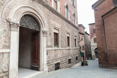 Photo for Old arch door in building facade in Siena - Royalty Free Image