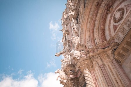 Photo for Gargoyles and Saints on facade of Siena Cathedral - Royalty Free Image