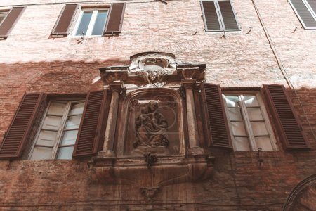 Photo for Classical statue on building facade in Siena - Royalty Free Image