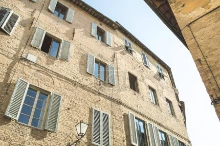 Photo for Brick building facade in historical quarter of Siena - Royalty Free Image