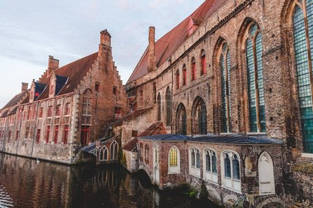 Photo for Beautiful ancient buildings and calm water of canal in brugge, belgium - Royalty Free Image