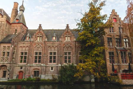 Photo for Beautiful ancient architecture reflected in canal at brugge, belgium - Royalty Free Image