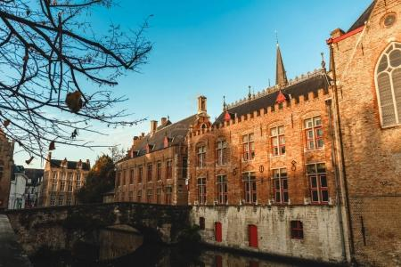 Photo for Beautiful old traditional buildings and bridge over canal in brugge, belgium - Royalty Free Image