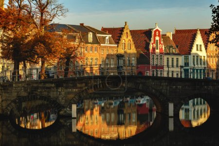 Photo for Beautiful od buildings reflected in water of canal at sunlight, brugge, belgium - Royalty Free Image