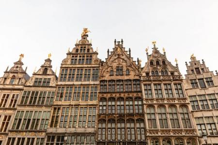 Photo for Low angle view of beautiful buildings with statues in historic quarter of Antwerp, Belgium - Royalty Free Image