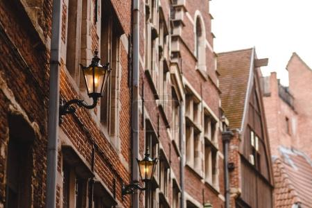 Photo for Illuminated lanterns on facade of house in historical quarter of Antwerp, Belgium - Royalty Free Image