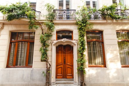 Photo for Entrance with wooden doors to the beautiful building with green plants in Antwerp, Belgium - Royalty Free Image