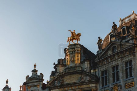 Photo for Low angle view of statues on antique buildings in brussels, belgium - Royalty Free Image