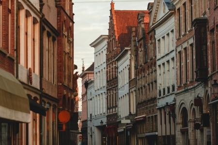 Photo for BRUGGE, BELGIUM - NOVEMBER 02, 2016: old narrow street with beautiful buildings in historic quarter of brugge, belgium - Royalty Free Image