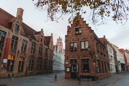 Photo for BRUGGE, BELGIUM - NOVEMBER 02, 2016: beautiful old traditional houses and narrow streets in brugge, belgium - Royalty Free Image