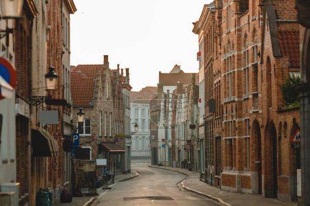 Photo for BRUGGE, BELGIUM - NOVEMBER 02, 2016: traditional belgian architecture on old narrow street in bruges - Royalty Free Image