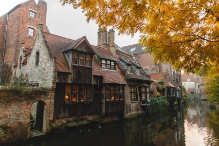 Photo for BRUGGE, BELGIUM - NOVEMBER 02, 2016: beautiful old buildings and calm water of canal in brugge, belgium - Royalty Free Image
