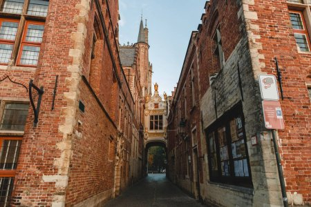 Photo for BRUGGE, BELGIUM - NOVEMBER 02, 2016: narrow street with archway and beautiful architecture in brugge, belgium - Royalty Free Image