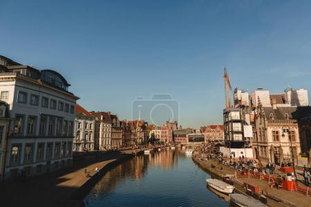 Photo for GHENT, BELGIUM - NOVEMBER 02, 2016: canal and buildings reflected in water at sunny day, Ghent, Belgium - Royalty Free Image