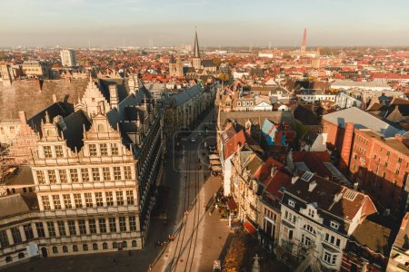 Photo for GHENT, BELGIUM - NOVEMBER 02, 2016: aerial view of old buildings and street in historical quarter of Ghent, Belgium - Royalty Free Image