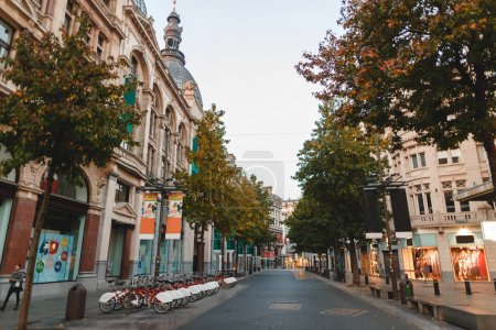 Photo for ANTWERP, BELGIUM - NOVEMBER 02, 2016: public bicycles and boutiques on street in Antwerp downtown, Belgium - Royalty Free Image