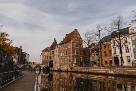 Photo for MECHELEN, BELGIUM - NOVEMBER 02, 2016: beautiful traditional buildings and canal in mechelen, belgium - Royalty Free Image