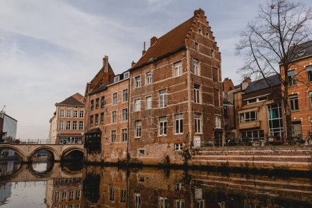 Photo for MECHELEN, BELGIUM - NOVEMBER 02, 2016: beautiful buildings and canal with bridge in mechelen, belgium - Royalty Free Image