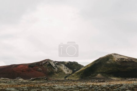 Photo for Beautiful scenic landscape with hills and cloudy sky in iceland - Royalty Free Image