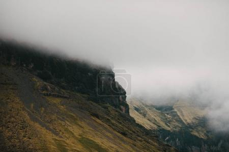 Photo for Beautiful scenic rocky hills in fog, iceland - Royalty Free Image