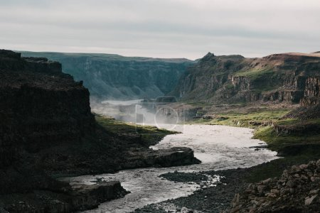 Photo for Beautiful scenic landscape with rapid river and rocky mountains in iceland - Royalty Free Image