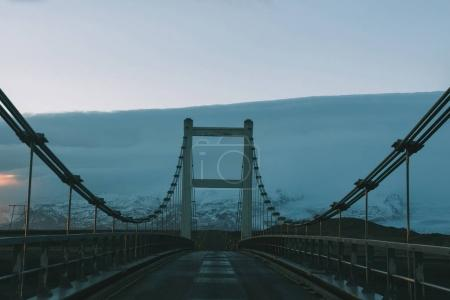 Photo for Driving on bridge at cold sunset in iceland - Royalty Free Image