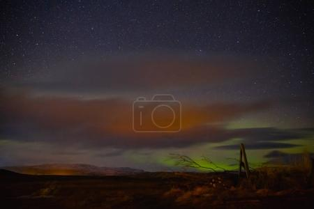 Photo for Spectacular  view of night sky with northern lights and stars in iceland - Royalty Free Image
