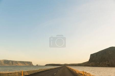 Photo for Empty asphalt road and water in iceland - Royalty Free Image